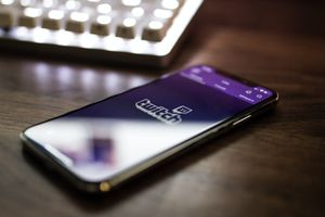 The Twitch Logo displayed on a smartphone.