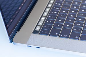A side view of a MacBook laptop with the USB-C ports at the front.