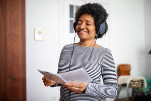 A woman enjoys her music on a set of headphones