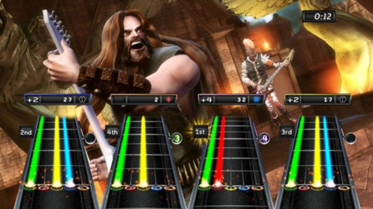 Guitar Hero 5 playing screen with four guitar rails and two in-game characters