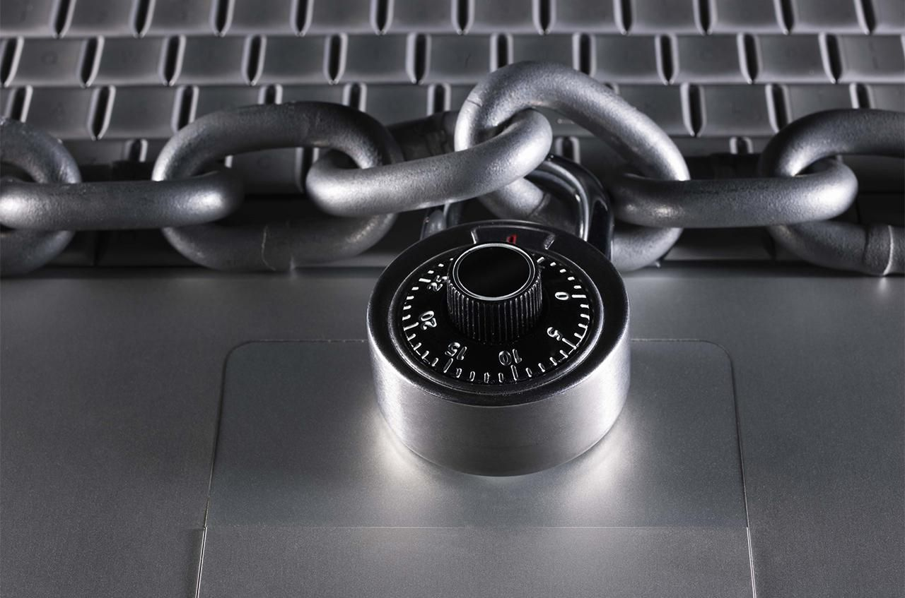 Padlock and chain on a laptop.