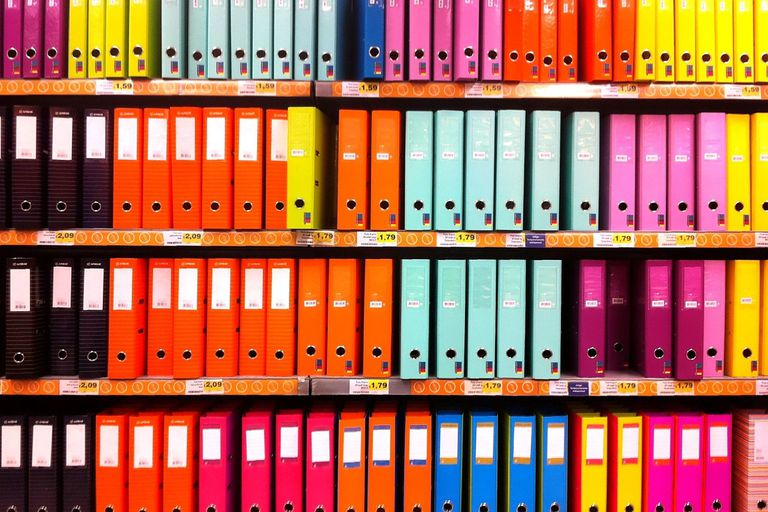 A wall full of binders and folders