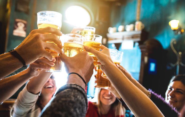 Friends Toasting Beer In Restaurant - stock photo taken In Forli, Italy