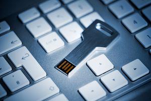 Key shaped USB flash drive on keyboard