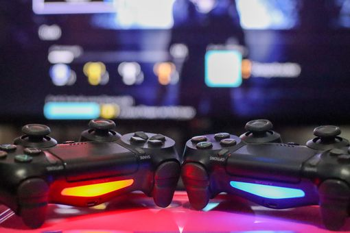 Close-Up Of Game Controllers On Table