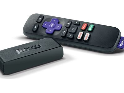 A Roku streaming stick and remote.