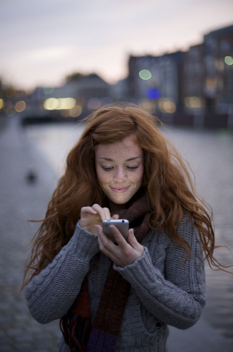 young woman with an iphone