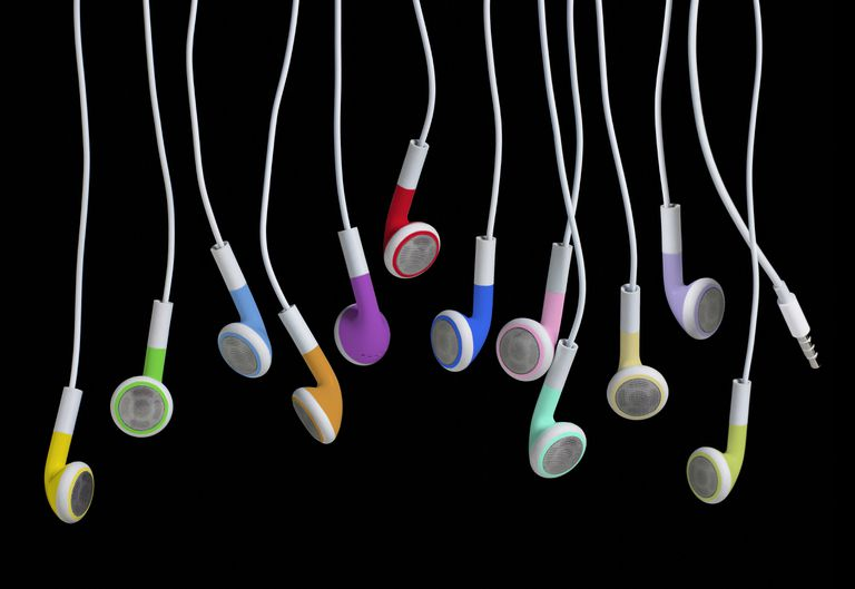 Colored head phones on a black background
