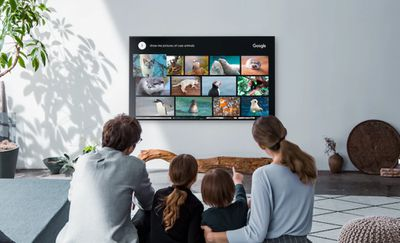 Family watching a Sony Z9D Series TV together