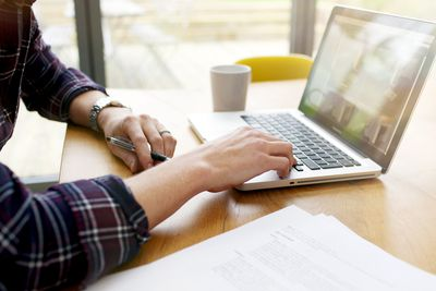 A man uses a laptop computer
