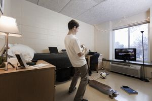 Student playing video games in dorm room