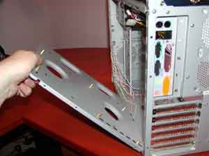 Removing the motherboard tray from a desktop computer case