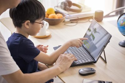 Setting up Windows 11 parental controls with a child.