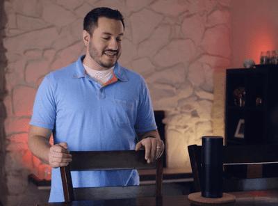 Man talking to Amazon Alexa device