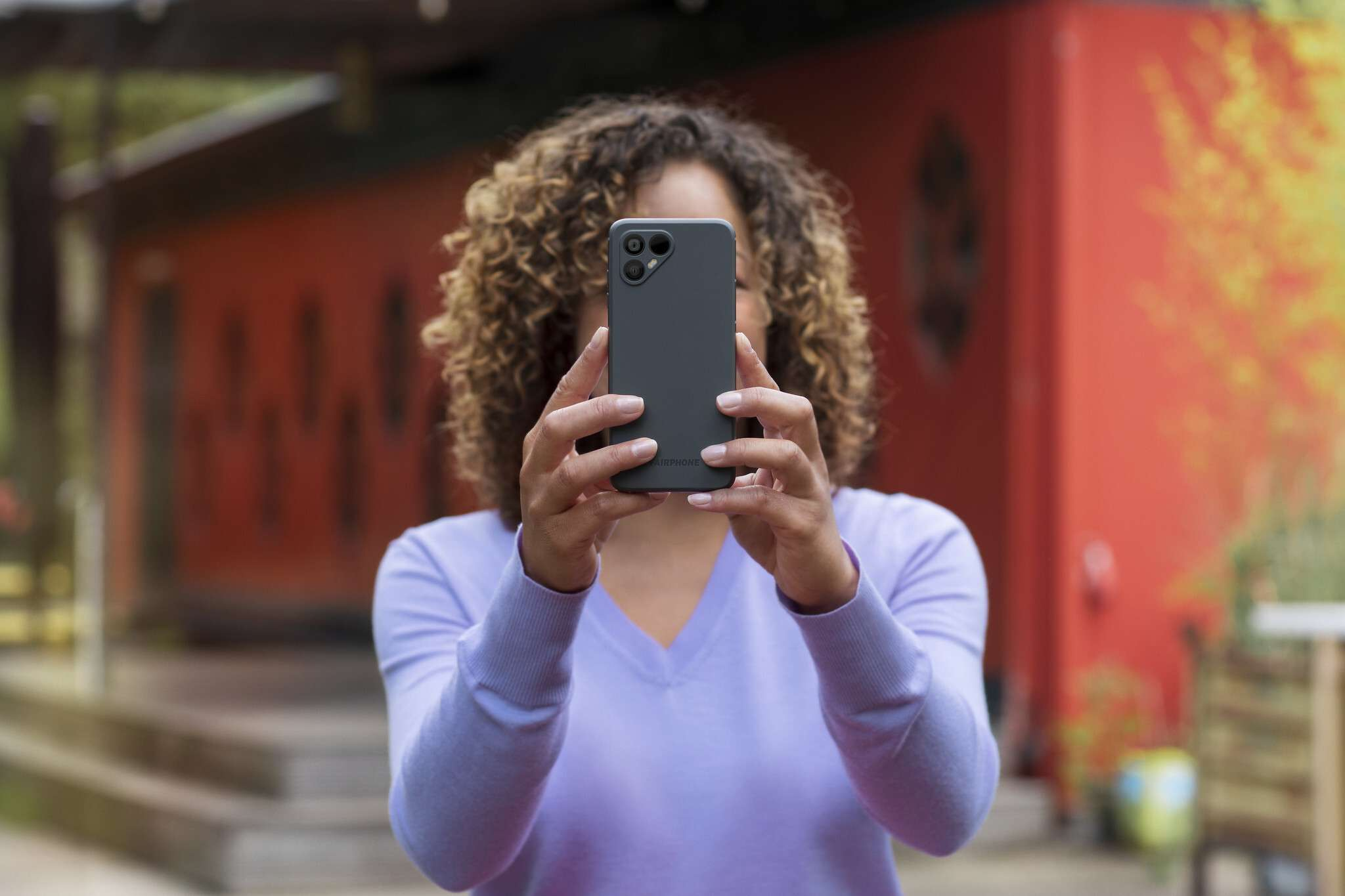 Someone using a Fairphone to take pictures.