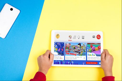 A child using YouTube Kids on a tablet.