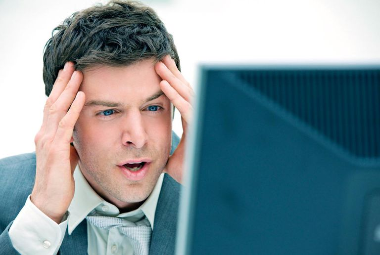 Shocked businessman looking at computer monitor