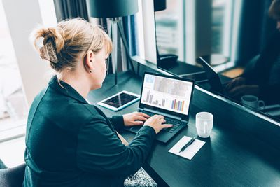 Data analyst using laptop to look at spreadsheet
