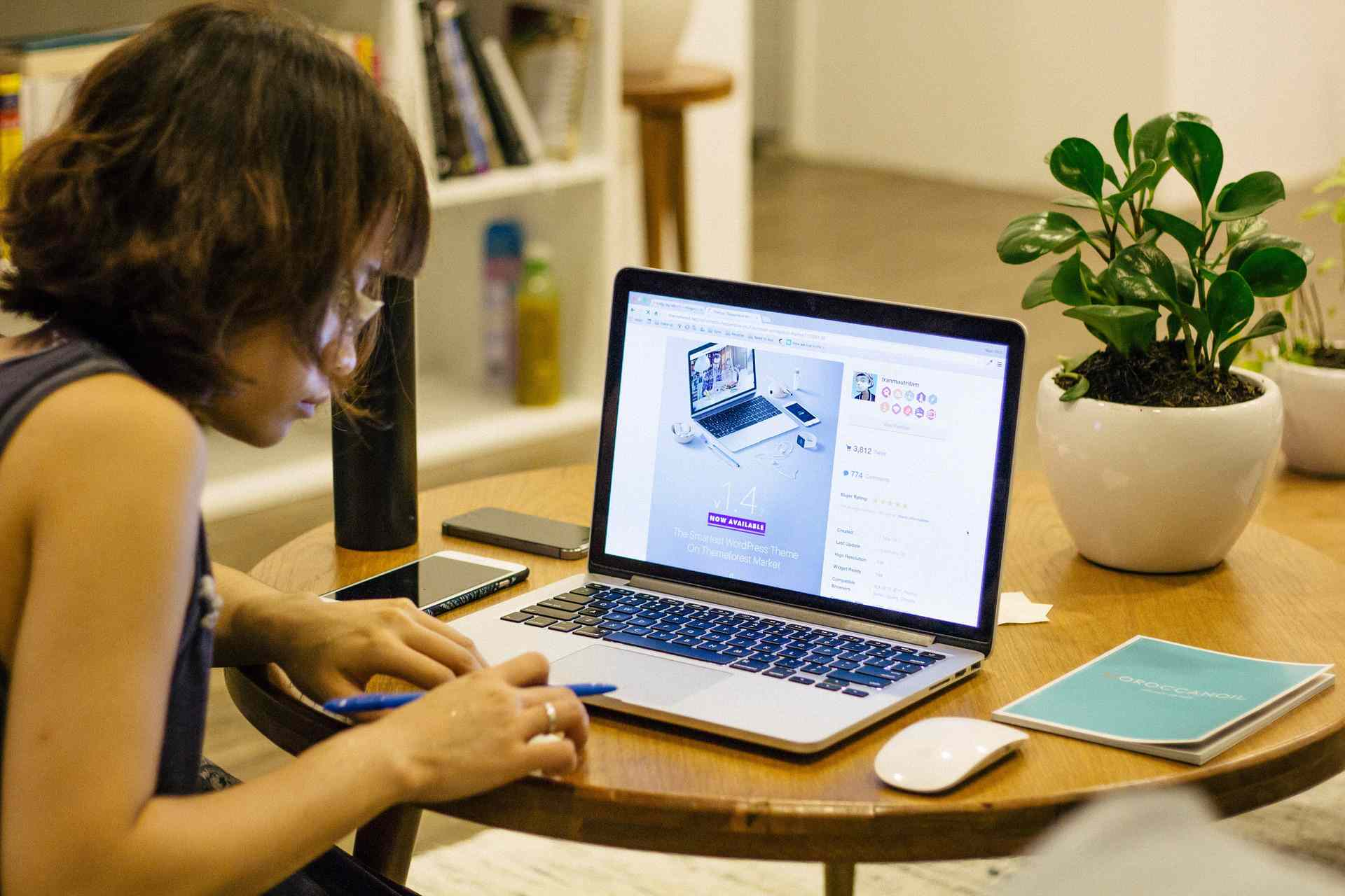 Woman working on table from home