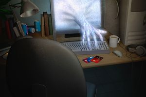 Hand reaching through computer screen