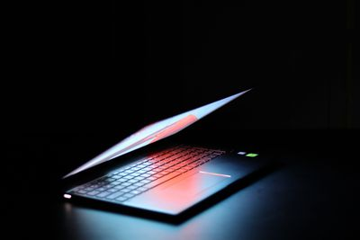 Laptop with screen light glowing