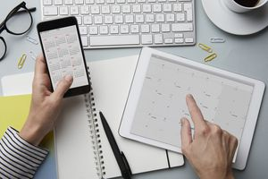Person using calendar on iPad and iPhone