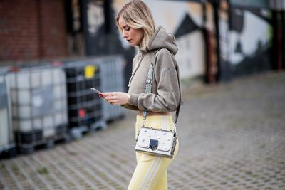 Woman walking with iPhone