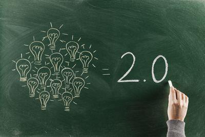 Lightbulbs and 2.0 written on a chalkboard