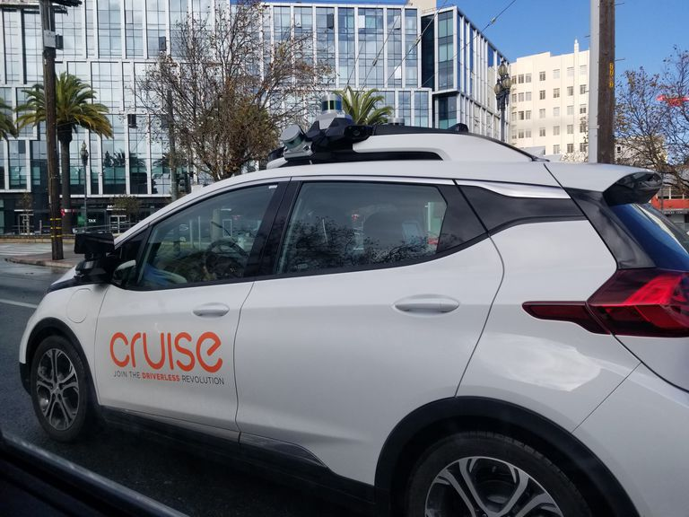 A GM Cruise driverless car operating on a city street in San Francisco.