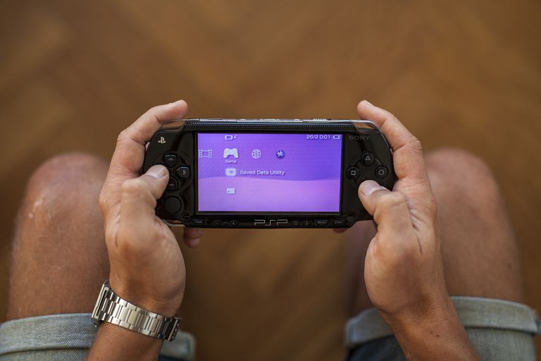 Man playing with a PlayStation Portable console