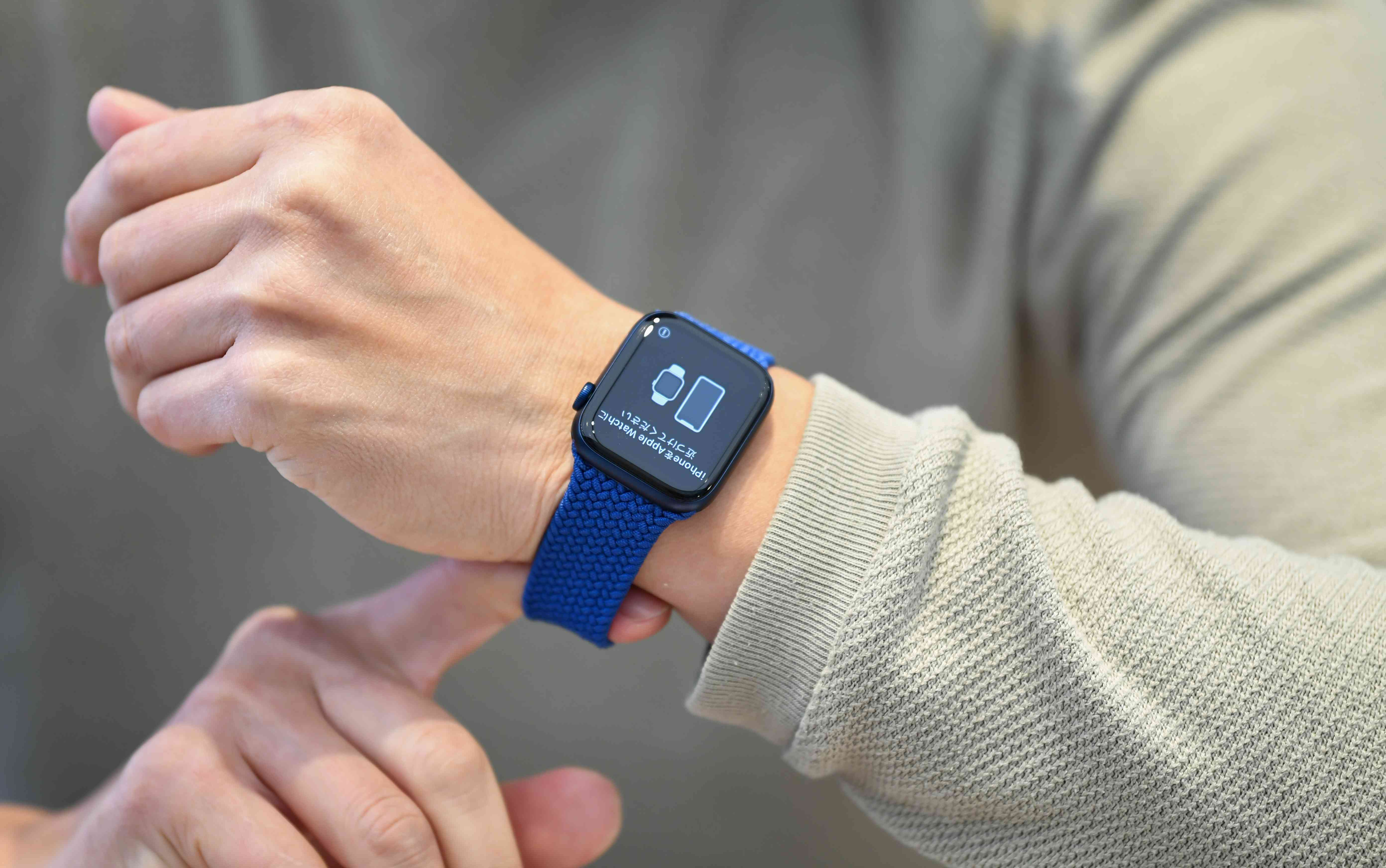 Apple Watch Series 6 with blue band on a wrist