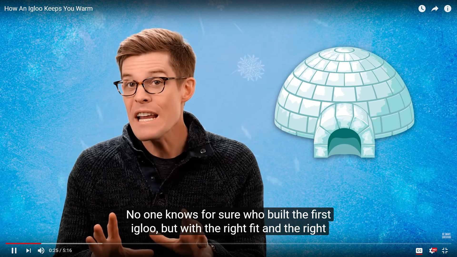 Joe Hanson explaining how igloos keep people warm in front of an illustration of an igloo