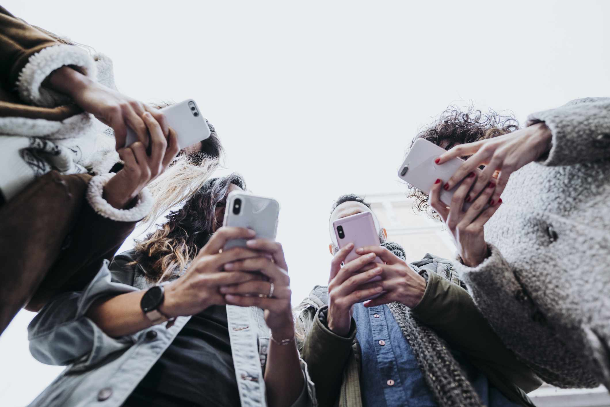 Group of friends staring at their smartphones