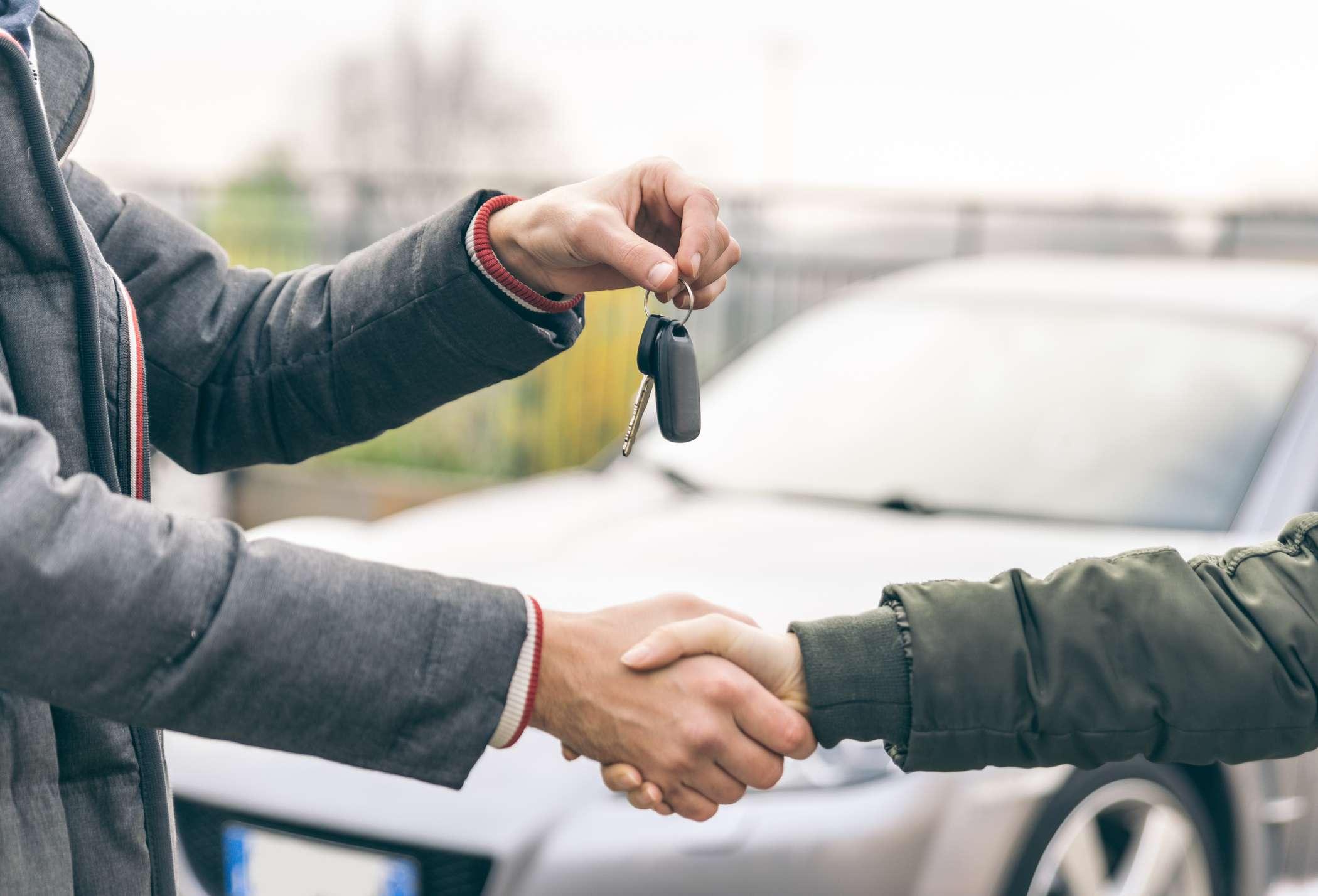A man handing over his keys