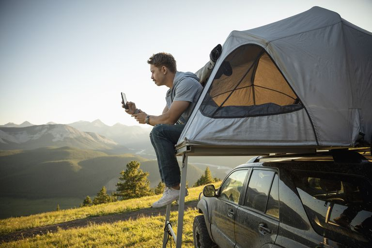 Camper using mobile phone