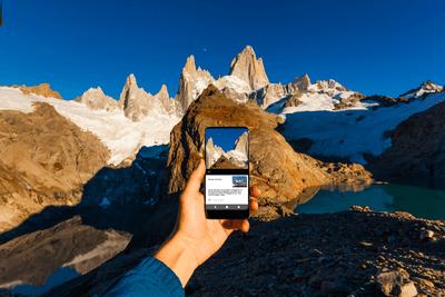 Mountain climber taking photo in the mountains.