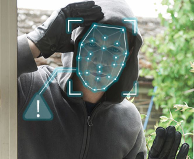 Facial recognition scan on a face peering into a window.