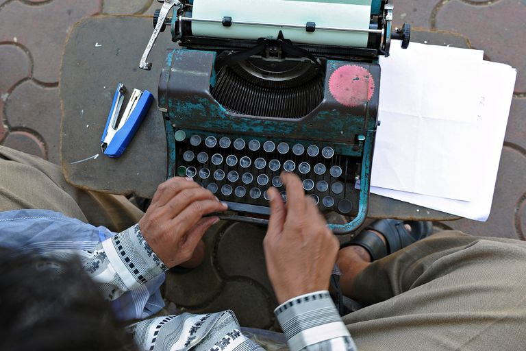 Indian man using typewriter