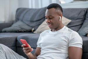 Man listening to music on smartphone
