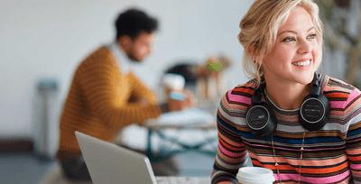 Woman wearing Plantronics headphones