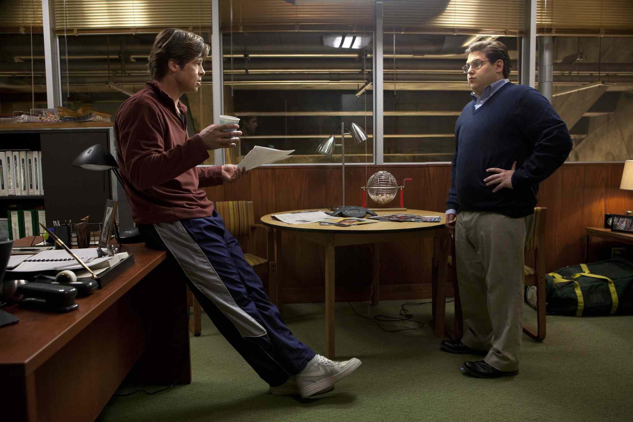 Brad Pitt and Jonah Hill in Moneyball (2011)