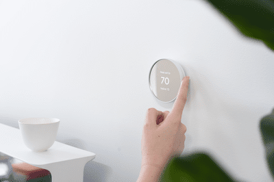 Google's Nest Thermostat set up on a white wall