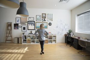 Woman looking at gallery wall in her home