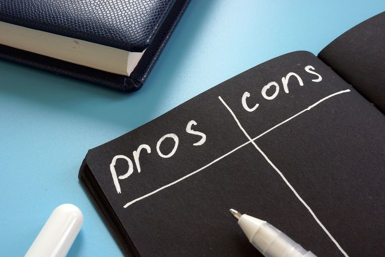 Pros and Cons list on the black page.