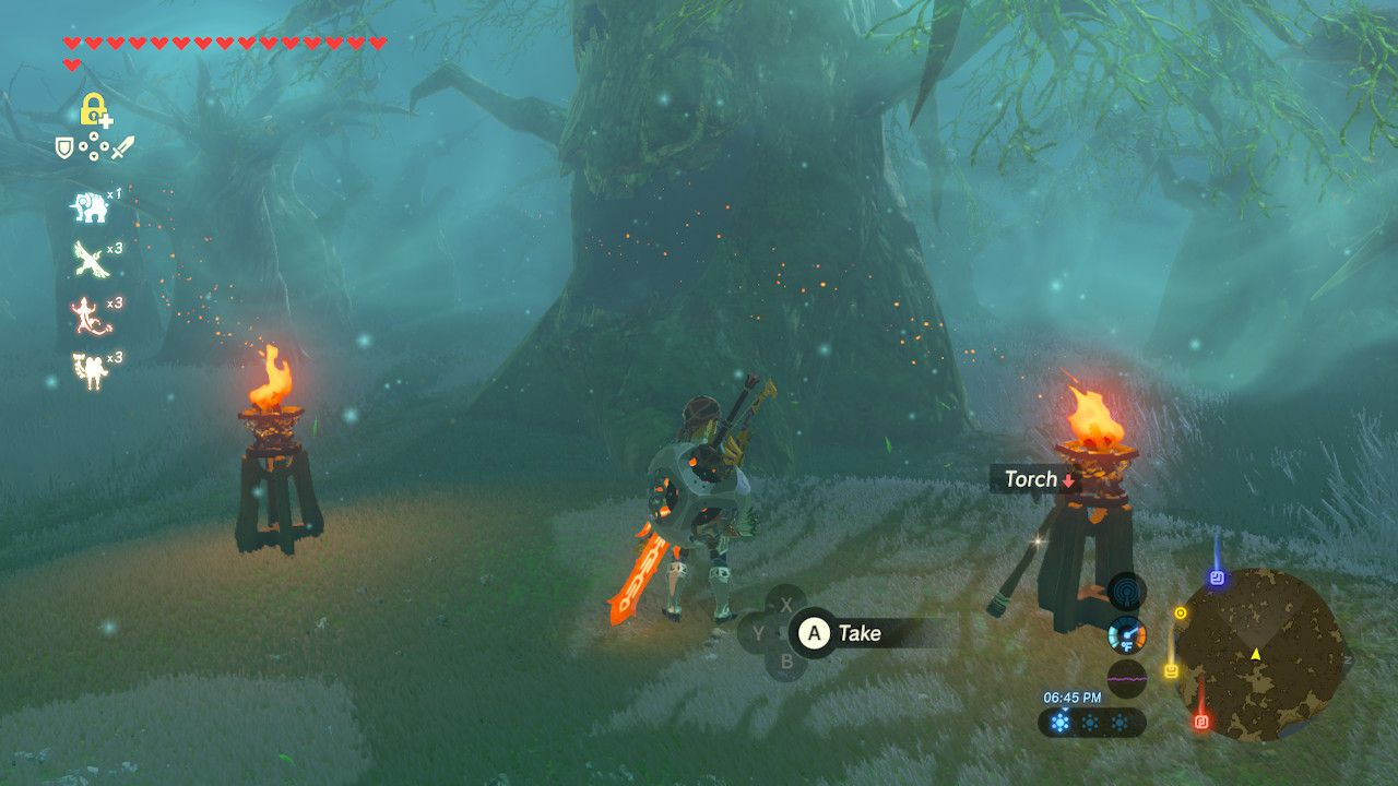 Standing between two lanterns in the Lost Woods in The Legend of Zelda: Breath of the Wild.