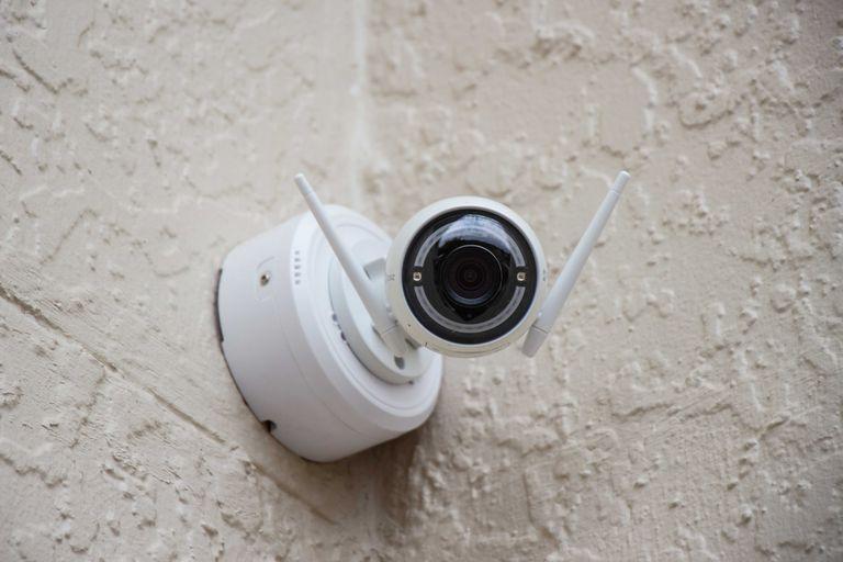 Wireless webcam mounted on outside wall