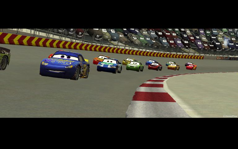 Cars from the video game racing around a track
