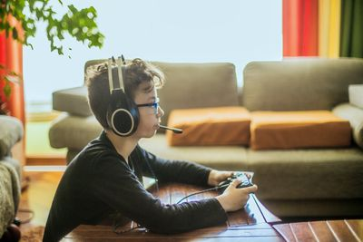 Boy playing video games with a headset