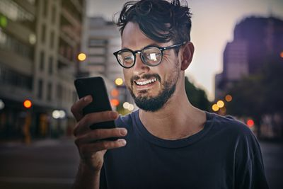 Person reading text message on a phone.