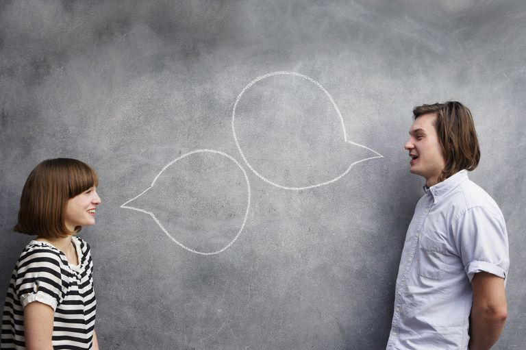 man and woman with speech bubbles on chalk board